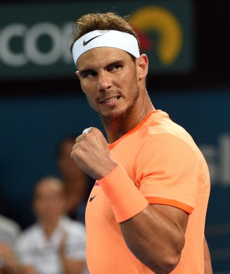 Rafael Nadal of Spain celebrates his victory against Alexandr Dolgopolov of Ukraine in the men's round one at the Brisbane International tennis tournament in Brisbane on January 3, 2017. / AFP / SAEED KHAN / IMAGE STRICTLY RESTRICTED TO EDITORIAL USE STRICTLY NO COMMERCIAL USE (Jan. 2, 2017 - Source: AFP)