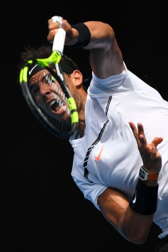 MELBOURNE, AUSTRALIA - JANUARY 17: Rafael Nadal of Spain serves in his first round match against Florian Mayer of Germany on day two of the 2017 Australian Open at Melbourne Park on January 17, 2017 in Melbourne, Australia. (Photo by Quinn Rooney/Getty Images)