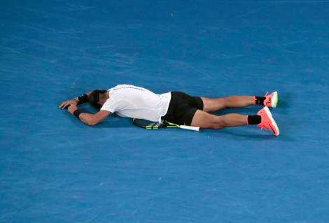 Tennis - Australian Open - Melbourne Park, Melbourne, Australia - early 28/1/17 Spain's Rafael Nadal falls onto the court as he celebrates winning his Men's singles semi-final match against Bulgaria's Grigor Dimitrov. REUTERS/Jason Reed TPX IMAGES OF THE DAY