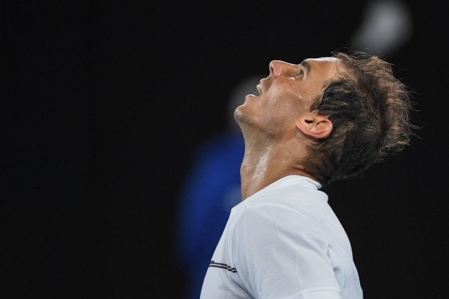 Spain's Rafael Nadal celebrates his victory against against Canada's Milos Raonic during their men's singles quarter-final match on day ten of the Australian Open tennis tournament in Melbourne on January 25, 2017. / AFP / WILLIAM WEST / IMAGE RESTRICTED TO EDITORIAL USE - STRICTLY NO COMMERCIAL USE (Jan. 24, 2017 - Source: AFP)