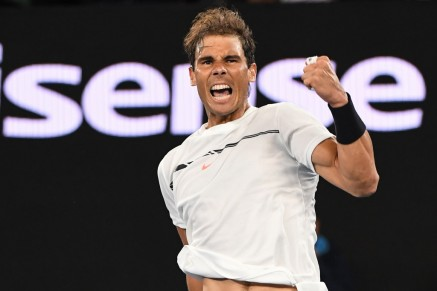 Spain's Rafael Nadal celebrates his victory against Canada's Milos Raonic during their men's singles quarter-final match on day ten of the Australian Open tennis tournament in Melbourne on January 25, 2017. / AFP / SAEED KHAN / IMAGE RESTRICTED TO EDITORIAL USE - STRICTLY NO COMMERCIAL USE (Jan. 24, 2017 - Source: AFP)