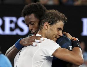 Spain's Rafael Nadal embraces France's Gael Monfils after winning their fourth round match at the Australian Open tennis championships in Melbourne, Australia, Monday, Jan. 23, 2017. (AP Photo/Aaron Favila)