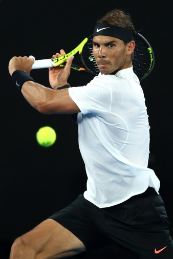 Rafael Nadal of Spain plays a backhand in his fourth round match against Gael Monfils of France on day eight of the 2017 Australian Open at Melbourne Park on January 23, 2017 in Melbourne, Australia. (Jan. 22, 2017 - Source: Cameron Spencer/Getty Images AsiaPac)