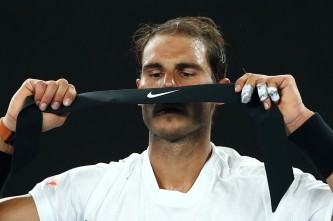 Rafael Nadal of Spain changes his headband in his fourth round match against Gael Monfils of France on day eight of the 2017 Australian Open at Melbourne Park on January 23, 2017 in Melbourne, Australia. (Jan. 22, 2017 - Source: Cameron Spencer/Getty Images AsiaPac)