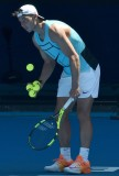 Rafael Nadal of Spain retrieves some balls during a practice session ahead of the Australian Open tennis tournament in Melbourne on January 12, 2017. / AFP / PAUL CROCK