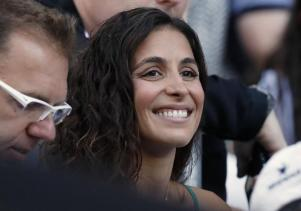 Xisca Perello, the girlfriend of Spain's Rafael Nadal, waits for the start of the men's final against Switzerland's Roger Federer at the Australian Open tennis championships in Melbourne, Australia, Sunday, Jan. 29, 2017. (AP Photo/Kin Cheung)