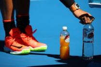 Rafael Nadal of Spain arranges his bottle of water in his third round match against Alexander Zverev of Germany on day six of the 2017 Australian Open at Melbourne Park on January 21, 2017 in Melbourne, Australia. (Jan. 20, 2017 - Source: Clive Brunskill/Getty Images AsiaPac)