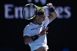 Spain's Rafael Nadal hits a return against Germany's Alexander Zverev during their men's singles third round match on day six of the Australian Open tennis tournament in Melbourne on January 21, 2017. / AFP / PETER PARKS / IMAGE RESTRICTED TO EDITORIAL USE - STRICTLY NO COMMERCIAL USE (Jan. 20, 2017 - Source: AFP)