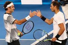 Tennis - Australian Open - Melbourne Park, Melbourne, Australia - 29/1/17 Switzerland's Roger Federer shakes hands after winning his Men's singles final match against Spain's Rafael Nadal. REUTERS/David Gray