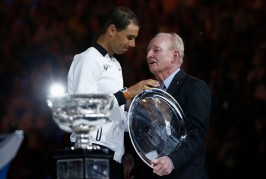 Tennis - Australian Open - Melbourne Park, Melbourne, Australia - 29/1/17 Spain's Rafael Nadal receives his runner up trophy from former Australian tennis player Rod Laver after losing to Switzerland's Roger Federer in their Men's singles final match. REUTERS/Thomas Peter