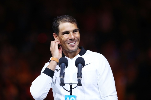 MELBOURNE, AUSTRALIA - JANUARY 29: Rafael Nadal of Spain accepts the runners up plate after the Men's Final match against Roger Federer of Switzerland on day 14 of the 2017 Australian Open at Melbourne Park on January 29, 2017 in Melbourne, Australia. (Photo by Cameron Spencer/Getty Images)