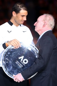 MELBOURNE, AUSTRALIA - JANUARY 29:  Rafael Nadal of Spain accepts the runners up plate from Rod Laver after the Men's Final match against Roger Federer of Switzerland on day 14 of the 2017 Australian Open at Melbourne Park on January 29, 2017 in Melbourne, Australia.  (Photo by Cameron Spencer/Getty Images)