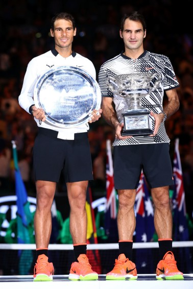 Roger Federer of Switzerland and Rafael Nadal of Spain pose after the Men's Final match on day 14 of the 2017 Australian Open at Melbourne Park on January 29, 2017 in Melbourne, Australia. (Jan. 28, 2017 - Source: Cameron Spencer/Getty Images AsiaPac)