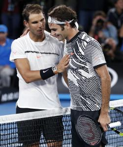 Switzerland's Roger Federer, right, is congratulated by Spain's Rafael Nadal after Federer won the men's singles final at the Australian Open tennis championships in Melbourne, Australia, Sunday, Jan. 29, 2017. (AP Photo/Dita Alangkara)