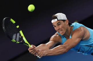 Rafael Nadal of Spain hits a return during a practice session ahead of the Australian Open tennis tournament in Melbourne on January 13, 2017. / AFP / PAUL CROCK (Jan. 12, 2017 - Source: AFP)
