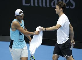 Spain's Rafael Nadal, left, takes his towel from coach Carlos Moya during a practice session ahead of the Australian Open tennis championships in Melbourne, Australia, Sunday, Jan. 15, 2017. (AP Photo/Aaron Favila)