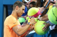 Rafael Nadal of Spain signs autographs after winning his match against Alexandr Dolgopolov of Ukraine on day three of the 2017 Brisbane International at Pat Rafter Arena on January 3, 2017 in Brisbane, Australia. (Jan. 2, 2017 - Source: Chris Hyde/Getty Images AsiaPac)