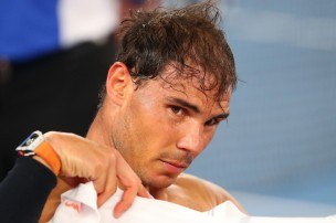 Rafael Nadal of Spain fixes his head band in his semifinal match against Grigor Dimitrov of Bulgaria on day 12 of the 2017 Australian Open at Melbourne Park on January 27, 2017 in Melbourne, Australia. (Jan. 26, 2017 - Source: Scott Barbour/Getty Images AsiaPac)