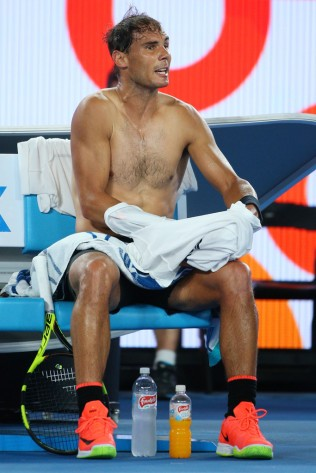 Rafael Nadal of Spain talks to the umpire while changing shirts between games in his semifinal match against Grigor Dimitrov of Bulgaria on day 12 of the 2017 Australian Open at Melbourne Park on January 27, 2017 in Melbourne, Australia. (Jan. 26, 2017 - Source: Michael Dodge/Getty Images AsiaPac)