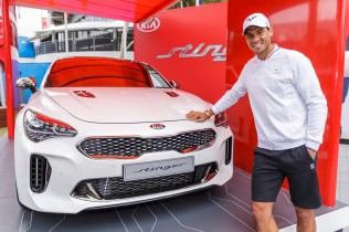 Rafael Nadal of Spain poses with a KIA Stinger during a Kia Key handover ceremony at Garden Square in Melbourne Park January 15, 2017 in Melbourne, Australia. (Jan. 14, 2017 - Source: Daniel Pockett/Getty Images AsiaPac)