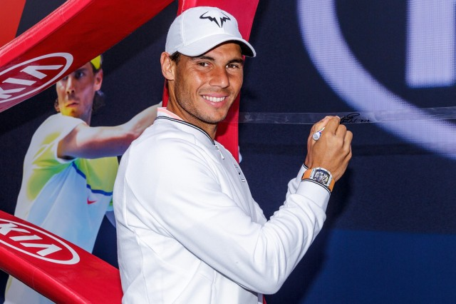 Rafael Nadal of Spain signs a string for the oversized raquet during a Kia Key handover ceremony at Garden Square in Melbourne Park January 15, 2017 in Melbourne, Australia. (Jan. 14, 2017 - Source: Daniel Pockett/Getty Images AsiaPac)