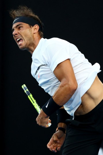 Rafael Nadal of Spain serves in his Men's Final match against Roger Federer of Switzerland on day 14 of the 2017 Australian Open at Melbourne Park on January 29, 2017 in Melbourne, Australia. (Jan. 28, 2017 - Source: Cameron Spencer/Getty Images AsiaPac)