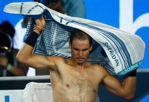 Tennis - Australian Open - Melbourne Park, Melbourne, Australia - 29/1/17 Spain's Rafael Nadal covers himself with a towel during his Men's singles final match against Switzerland's Roger Federer. REUTERS/Thomas Peter