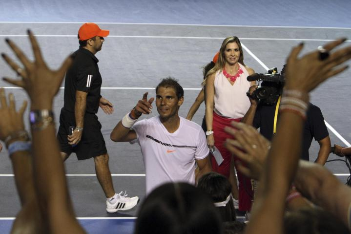 Spain's Rafael Nadal greets the crowd after defeating Japan's Yoshihito Nishioka in a quarterfinal match during the Mexican Tennis Open in Acapulco, Mexico, Thursday, March 2, 2017. (AP Photo/Bernandino Hernandez)