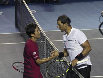 Spain's Rafael Nadal, right, greets Japan's Yoshihito Nishioka after their quarterfinal match at the Mexican Tennis Open in Acapulco, Mexico, Thursday, March 2, 2017. Nadal won the match. (AP Photo/Enric Marti)