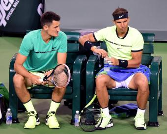 INDIAN WELLS, CA - MARCH 10: Rafael Nadal of Spain and Bernard Tomic of Australia talk before play in the men's doubles against Pablo Carreno Busta of Spain and Joao Sousa of Portugal at Indian Wells Tennis Garden on March 10, 2017 in Indian Wells, California. (Photo by Harry How/Getty Images)