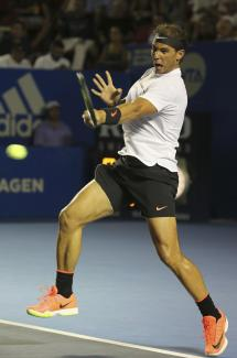 Spain's Rafael Nadal returns to Croatia's Marini Cilic during a semifinal match of the Mexican Tennis Open in Acapulco, Mexico, Friday March 3, 2017. (AP Photo/Enric Marti)