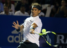 Spain's Rafael Nadal plays a return to Croatia's Marini Cilic during a semifinal match of the Mexican Tennis Open in Acapulco, Mexico, Friday March 3, 2017. (AP Photo/Enric Marti)