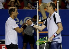 Tennis - Mexican Open - Men's Singles - Final - Acapulco, Mexico- 04/03/17. USA's Sam Querrey (R) shakes hands with Spain's Rafael Nadal after winning his final match. REUTERS/Henry Romero