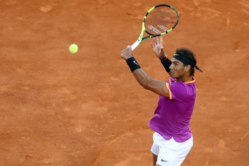 Spain's Rafael Nadal returns the ball to Argentina's Diego Schwartzman during the Monte-Carlo ATP Masters Series Tournament tennis match, on April 21, 2017 in Monaco. / AFP PHOTO / VALERY HACHE