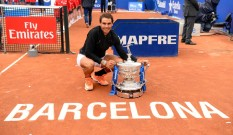 "Spanish tennis player Rafael Nadal poses with his trophy as he celebrates after winning Austrian tennis player Dominic Thiem at the end of the ATP Barcelona Open ""Conde de Godo"" tennis tournament final in Barcelona on April 30, 2017..Nadal won 6-4, 6-1. / AFP PHOTO / Josep LAGO (April 29, 2017 - Source: AFP)"