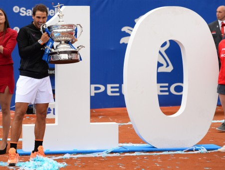 """Spanish tennis player Rafael Nadal poses with his trophy as he celebrates after winning Austrian tennis player Dominic Thiem at the end of the ATP Barcelona Open """"Conde de Godo"""" tennis tournament final in Barcelona on April 30, 2017..Nadal won 6-4, 6-1. / AFP PHOTO / Josep LAGO (April 29, 2017 - Source: AFP)"""