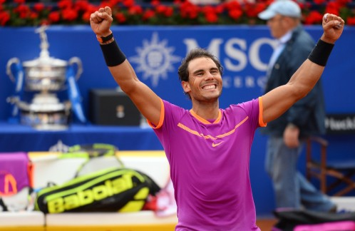 """Spanish tennis player Rafael Nadal celebrates his victory over Austrian tennis player Dominic Thiem at the end of the ATP Barcelona Open """"Conde de Godo"""" tennis tournament final in Barcelona on April 30, 2017..Nadal won 6-4, 6-1. / AFP PHOTO / Josep LAGO (April 29, 2017 - Source: AFP)"""