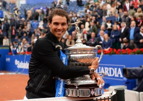 """Spanish tennis player Rafael Nadal celebrates with his trophy after winning Austrian tennis player Dominic Thiem at the end of the ATP Barcelona Open """"Conde de Godo"""" tennis tournament final in Barcelona on April 30, 2017..Nadal won 6-4, 6-1. / AFP PHOTO / Josep LAGO (April 29, 2017 - Source: AFP)"""