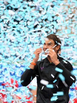 "Spanish tennis player Rafael Nadal celebrates after winning Austrian tennis player Dominic Thiem at the end of the ATP Barcelona Open ""Conde de Godo"" tennis tournament final in Barcelona on April 30, 2017..Nadal won 6-4, 6-1. / AFP PHOTO / Josep LAGO (April 29, 2017 - Source: AFP)"