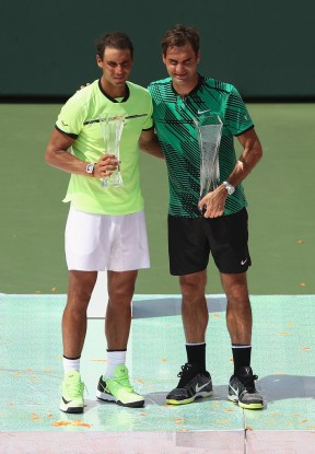 Winner Roger Federer of Switzerland with the trophy next to runner up Rafael Nadal of Spain after the final at Crandon Park Tennis Center on April 2, 2017 in Key Biscayne, Florida. (April 1, 2017 - Source: Julian Finney/Getty Images North America)