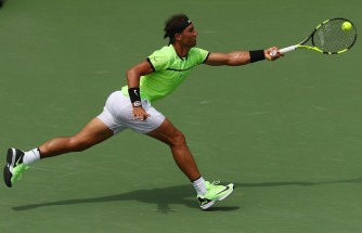 Rafael Nadal of Spain returns a shot against Roger Federer of Switzerland during the Men's Final and day 14 of the Miami Open at Crandon Park Tennis Center on April 2, 2017 in Key Biscayne, Florida. (April 1, 2017 - Source: Al Bello/Getty Images North America)