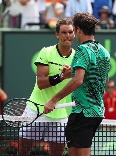 Rafael Nadal of Spain meets Roger Federer of Switzerland after losing the match after the Men's Final and day 14 of the Miami Open at Crandon Park Tennis Center on April 2, 2017 in Key Biscayne, Florida. (April 1, 2017 - Source: Al Bello/Getty Images North America)