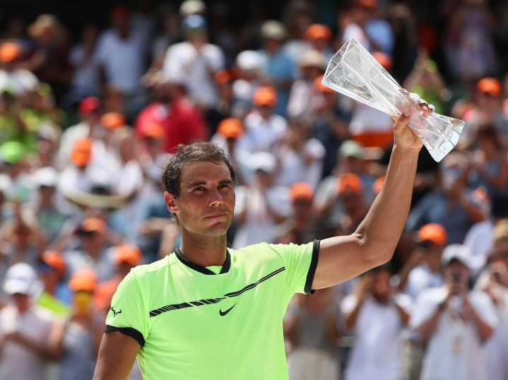 Rafael Nadal of Spain holds the runners up trophy after losing to Roger Federer of Switzerland after the Men's Final and day 14 of the Miami Open at Crandon Park Tennis Center on April 2, 2017 in Key Biscayne, Florida. (April 1, 2017 - Source: Al Bello/Getty Images North America)