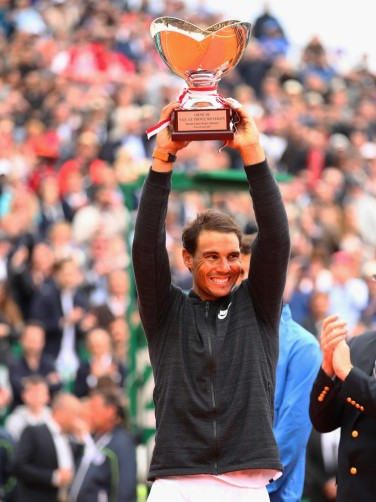 Rafael Nadal of Spain holds aloft his winners trophy after his straight set victory against Albert Ramos-Vinolas of Spain in the final on day eight of the Monte Carlo Rolex Masters at Monte-Carlo Sporting Club on April 23, 2017 in Monte-Carlo, Monaco. (April 22, 2017 - Source: Clive Brunskill/Getty Images Europe)