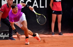 Rafael Nadal of Spain runs to catch a ball as he plays against Dominic Thiem of Austria during their quarter-final tennis match at the ATP Tennis Open tournament on May 19, 2017 at the Foro Italico in Rome..Austria's Dominic Thiem sent Rafael Nadal crashing out of the Rome Masters with a 6-4, 6-3 quarter-final victory, ending the Spaniard's 17-match winning run. / AFP PHOTO / TIZIANA FABI (May 18, 2017 - Source: AFP)