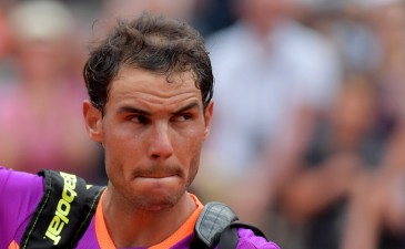Rafael Nadal of Spain leaves the court after he lost his quarter-final against Dominic Thiem of Austria during the ATP Tennis Open tournament on May 19, 2017 at the Foro Italico in Rome..Austria's Dominic Thiem sent Rafael Nadal crashing out of the Rome Masters with a 6-4, 6-3 quarter-final victory, ending the Spaniard's 17-match winning run. / AFP PHOTO / TIZIANA FABI (May 18, 2017 - Source: AFP)