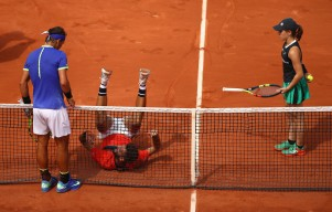 Rafael Nadal of Spain watches Benoit Paire of France fall into the net during their mens singles first round match on day two of the 2017 French Open at Roland Garros on May 29, 2017 in Paris, France. (May 28, 2017 - Source: Clive Brunskill/Getty Images Europe)