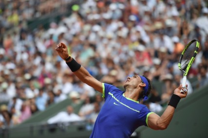 Spain's Rafael Nadal serves to France's Benoit Paire during their tennis match at the Roland Garros 2017 French Open on May 29, 2017 in Paris. / AFP PHOTO / Lionel BONAVENTURE (May 28, 2017 - Source: AFP)