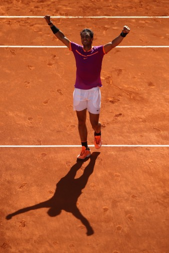 Rafael Nadal of Spain celebrates after beating Novak Djokovic of Serbia in their semi-final match during day eight of the Mutua Madrid Open tennis at La Caja Magica on May 13, 2017 in Madrid, Spain. (May 12, 2017 - Source: Denis Doyle/Getty Images Europe)