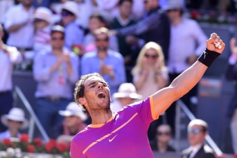 Spanish tennis player Rafael Nadal celebrates his victory over Serbian tennis player Novak Djokovic during their ATP Madrid Open semifinal match in Madrid, on May 13, 2017..Nadal won 6-2 and 6-4. / AFP PHOTO / JAVIER SORIANO (May 12, 2017 - Source: AFP)